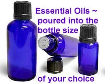 essential oils poured into the bottle size of your choice
